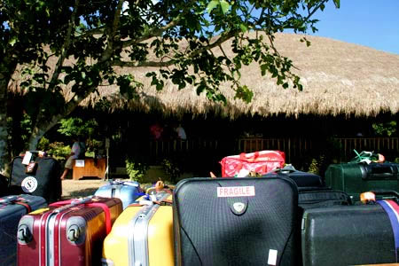 How tough is your stuff, unloaded bags and suitcases at El Nido's dusty island landing strip