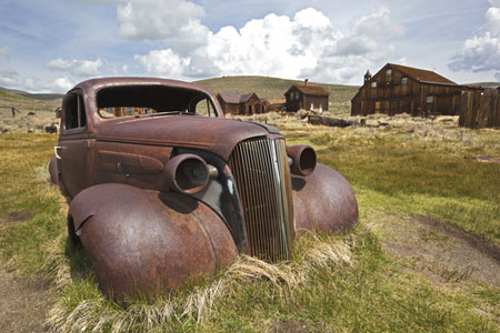 Rusting vintage car - whatever happened to simple travel terms and classic holidays?