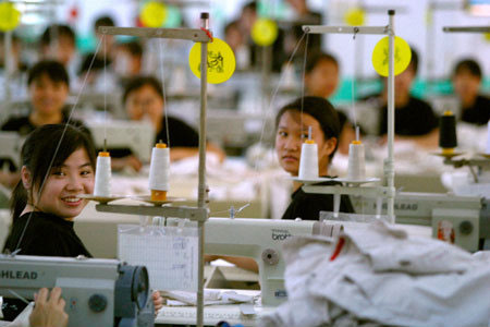 Chinese textile factory workers pause to chat