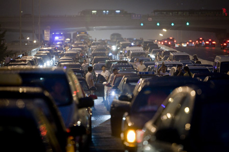 Beijing traffic jam - Long queues of cars grind to a halt as drivers talk to each other perplexed