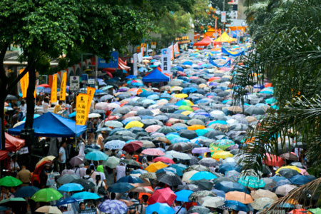 Hong Kong protestors brave the rains in a sea of umbrellas as they march for democracy, July 2014