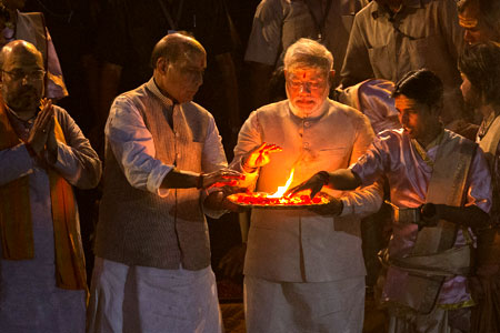 BJP leader Narendra Modi, (centre), performs Hindu rituals on the banks of the river Ganges