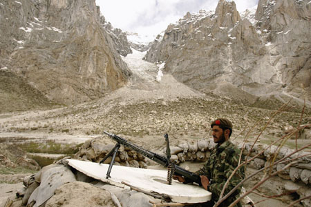 Pakistan sentry guards a post near the Siachen Glacier in the Himalayas
