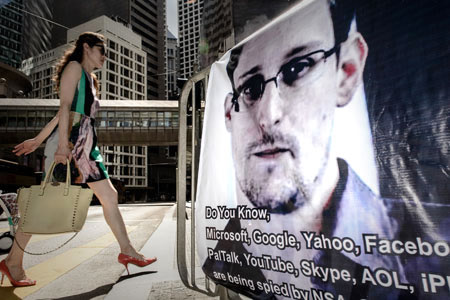 Edward Snowden poster in Hong Kong, 18 June, 2013. The 29-year-old former contractor for the National Security Agency exposed a US global surveillance network