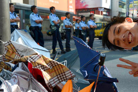 The umbrella protests brought Hong Kong to a halt late 2014 - police clear the debris
