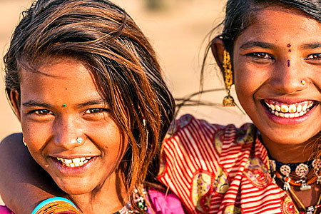 Big Indian smiles - but they may disappear in all the machinations to make the country saffron